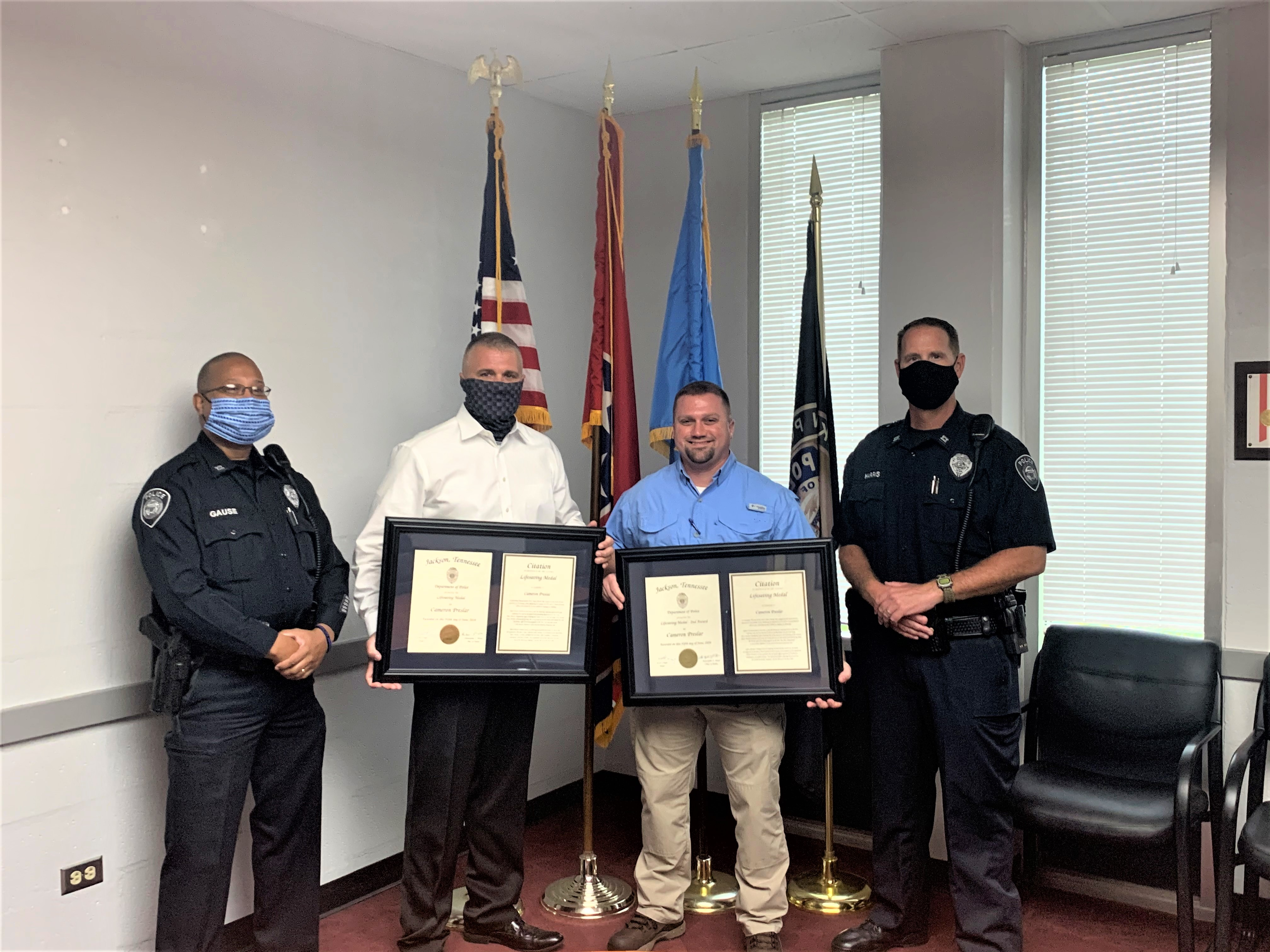 Former Jackson Police Officer receives medal for heroic act.