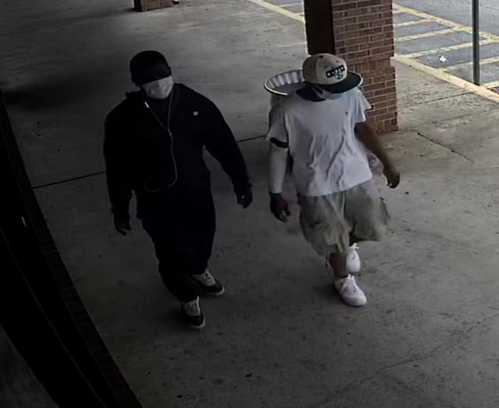 The Jackson Police Department needs assistance identifying two suspects from an armed robbery at Metro PCS.